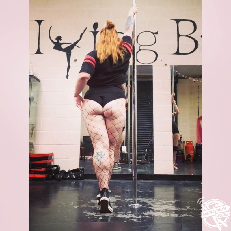 plus size pole dancer who is encouraging other curvy women to take